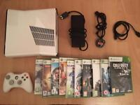 Xbox 360 SLIM console , like new , with 10 games - £89