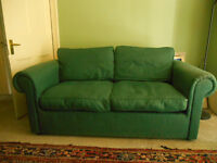 Green cotton sofa, free. Worn but serviceable. Feather cushions. Buyer to collect