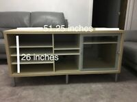 Well set up TV stand with several compartments