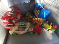 Wooden toy bundle including train set, tool box, truck and cars