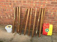Wooden posts, postcrete and chain