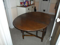 Vintage oak oval drop leaf table