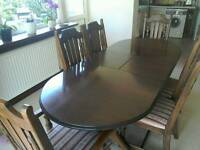 Dark oak dining table and 6 chairs