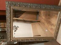 Brass effect ornate mirror