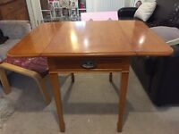 Solid yew wood drop leaf table and one chair