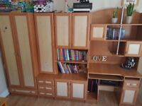 furniture set with lots of storage space including a desk, wardrobe, many shelves