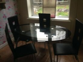 Four chairs and glass table very good condition 50 quid