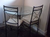 Circular Glass Dining Table + 2 Chairs
