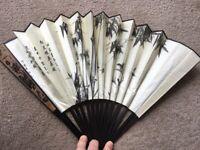 Decorative Chinese folding fabric and bamboo fan.