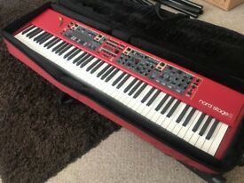 Nord Stage 2 88 with case and music stand