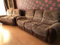 Three and two seater real hide and fabric recliner sofas. Excellent Condition