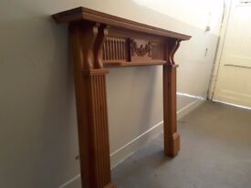 Solid wooden fire surround.