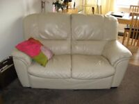 2x2 seater sofas 1-electric recliner,1- static. Beige leather