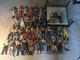 Collection of 36 WWE Jakks Wrestling Figures and Ring.