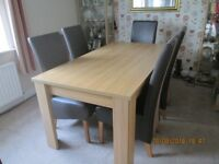 Dinning room table oak effect with 6 faux leather and suede chairs