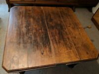 Stately old Victorian oak (?) wind-out dining table with extension leaf