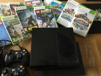 X-box 360 with 2 controllers and 14 games !