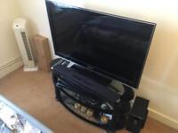 "Samsung 40"" Full HDTV + Panasonic Soundbar + TV Stand"