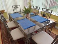 5'x3' Metal framed table with glass top & 6 matching chairs for sale