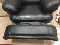Black leather recliner sofa