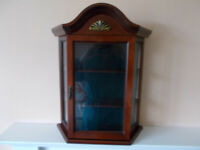 Small, decorative wooden display cabinet
