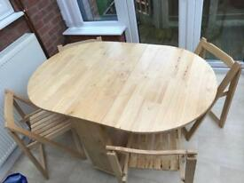 Butterfly wood effect 4 seater dining table.