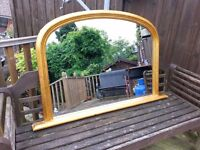 large gold leaf effect oval mirror