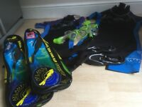 Two sets of wetsuits with snorkels, shoes and flippers