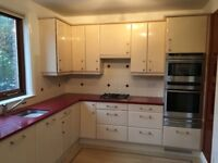 Kitchen Units, good condition with red quartz worktop. Will be available towards the end of January.