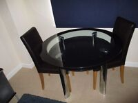 Must go: Black Glass Dining Table and 2 chairs.