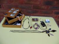 Jewellery box by Umbro, with some costume jewellery, perfect condition.