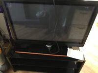 42 inch tv with glass stand