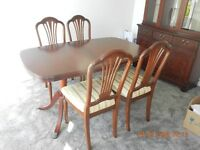 Extending Dining table, chairs and Display cabinet