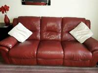 Red leather 3 seater couch and 2 seater couch.