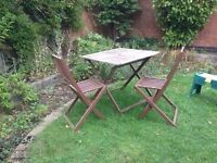 Small folding garden table and two folding chairs
