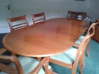 Light mahogany dining table & six chairs + display cabinet