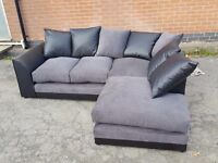 Beautiful brand new corner sofa.black leather base.small tear. can deliver