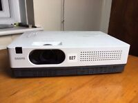 As new slim Sanyo PLC-XW200 AV projector in carrying case. Very long lamp life