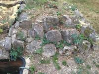 Large grey rocks and plastic pond