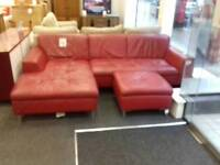 Red leather corner sofa with footstool at BHF Glasgow