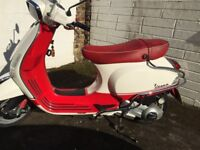 Vespa 125cc motor scooter in red white colourway, one careful owner