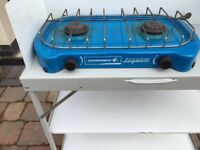 Camping cooker with kitchen stand