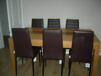 oak dining table and 6 faux leather chairs used