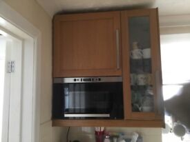 Beech kitchen to include intergrated microwave oven, gas hob and washing machine.