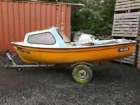 Half cabin fishing boat and trailer