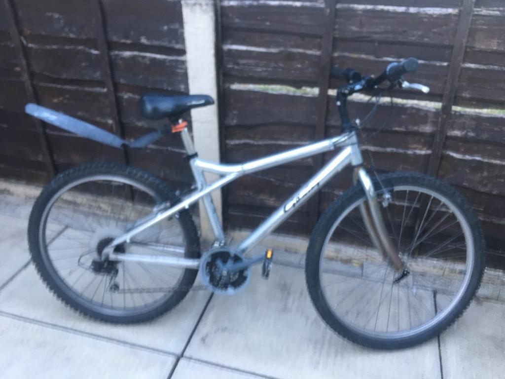 Mountain bike for salein Bury, Manchester - Mountain bike for sale in good condition the front tyre is a bit loose just needs tightening not got the time for it still riding fine gears working fine
