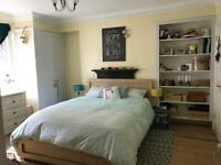 Spacious en-suite master bedroom, with living-room and garden