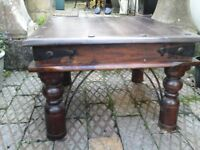 Lovely solid dark wood coffee table.