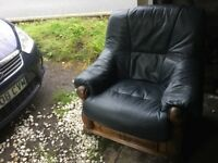 2 leather chairs expensive furniture with oak wood surround