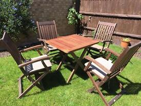 Teak garden table and 4 wooden chairs with cushions - fold away
